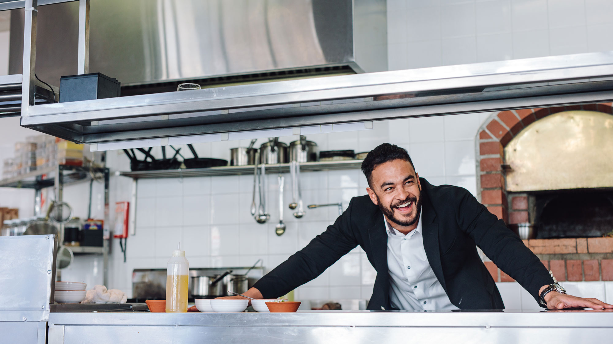 Man in kitchen smiling