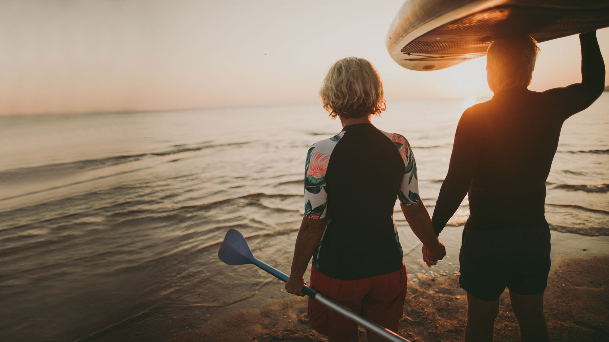 man and woman going surfing