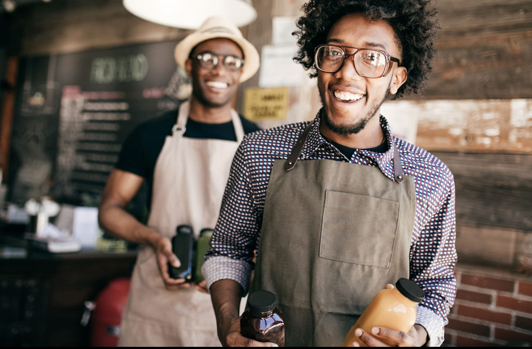 Two business owners smiling