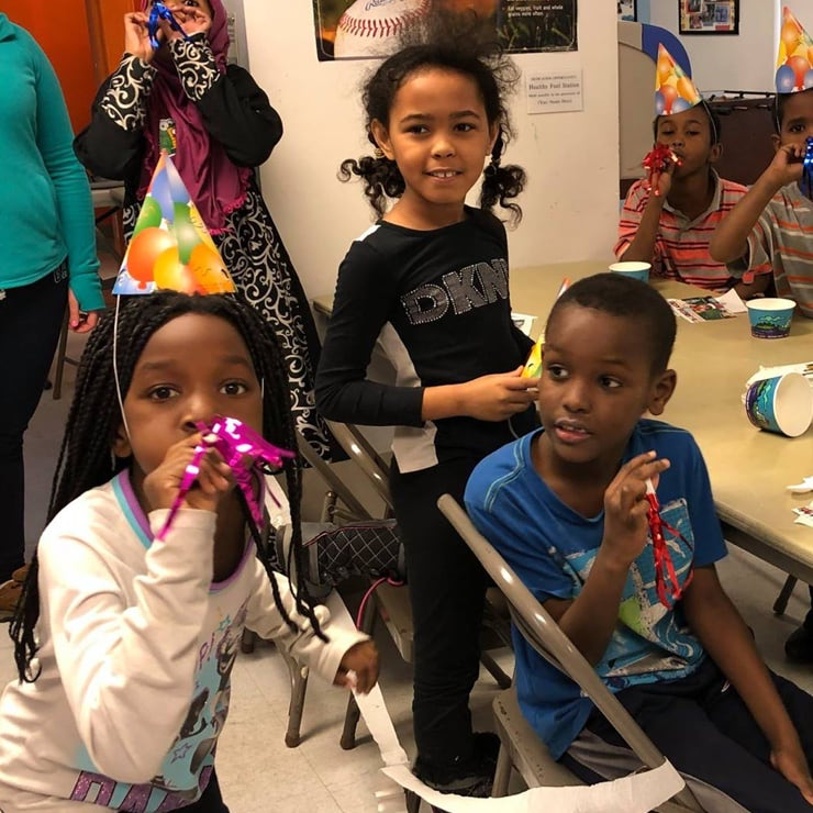 Kids with birthday hats on and noise makers