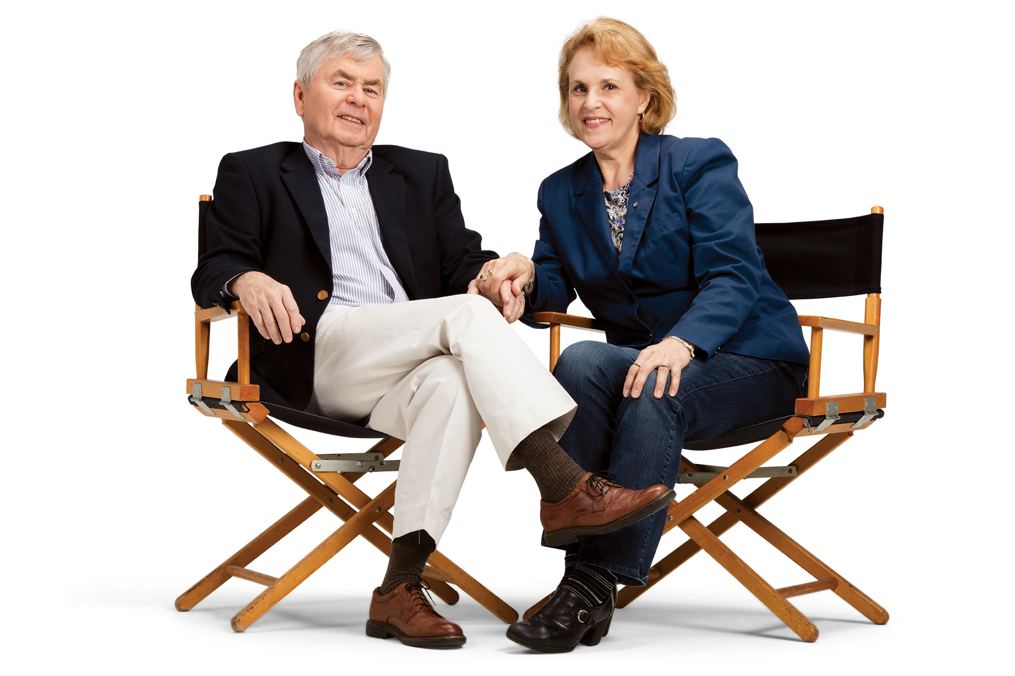 Happy Elderly Couple sitting in directors chairs