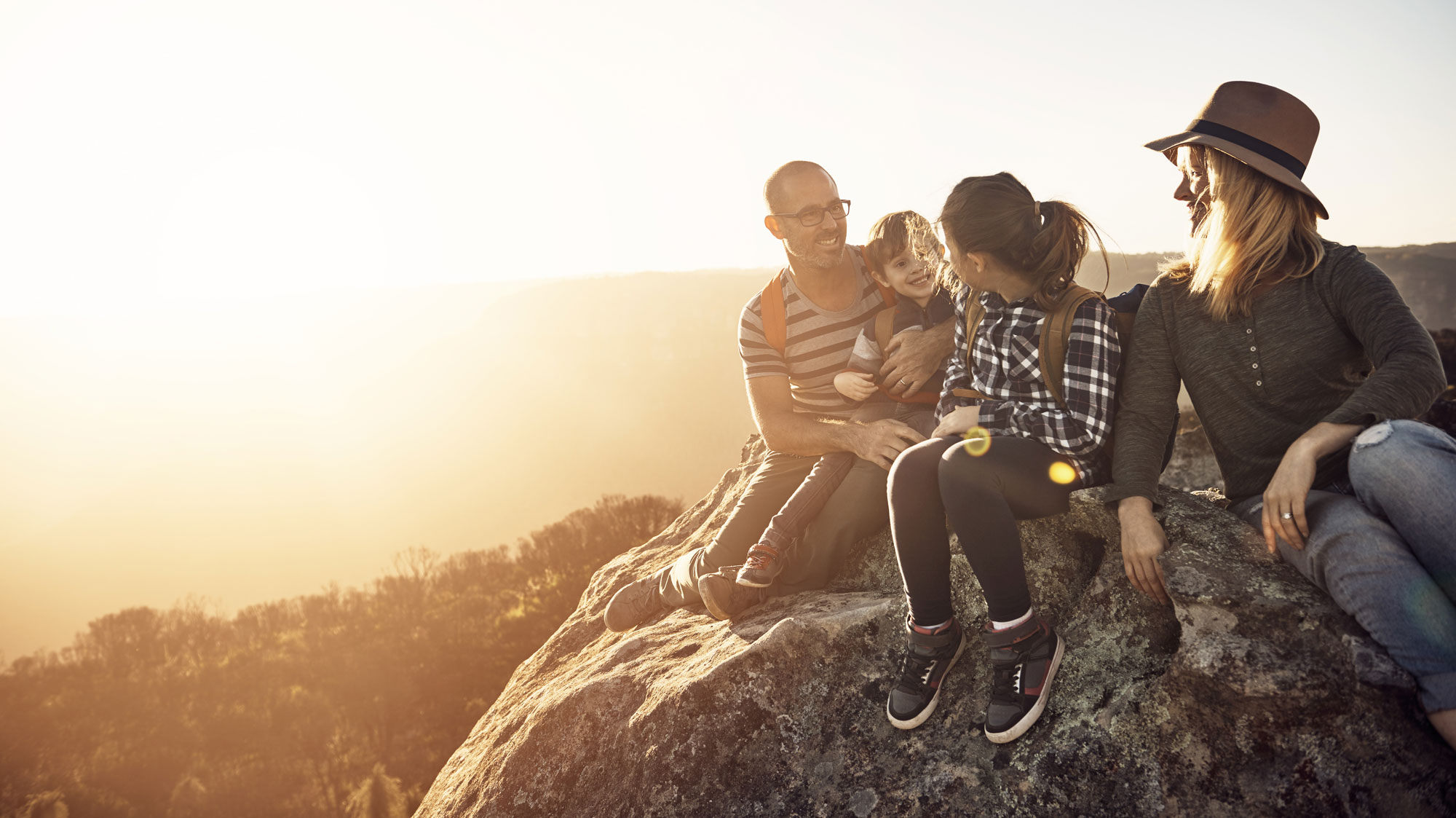 People sitting on a rock
