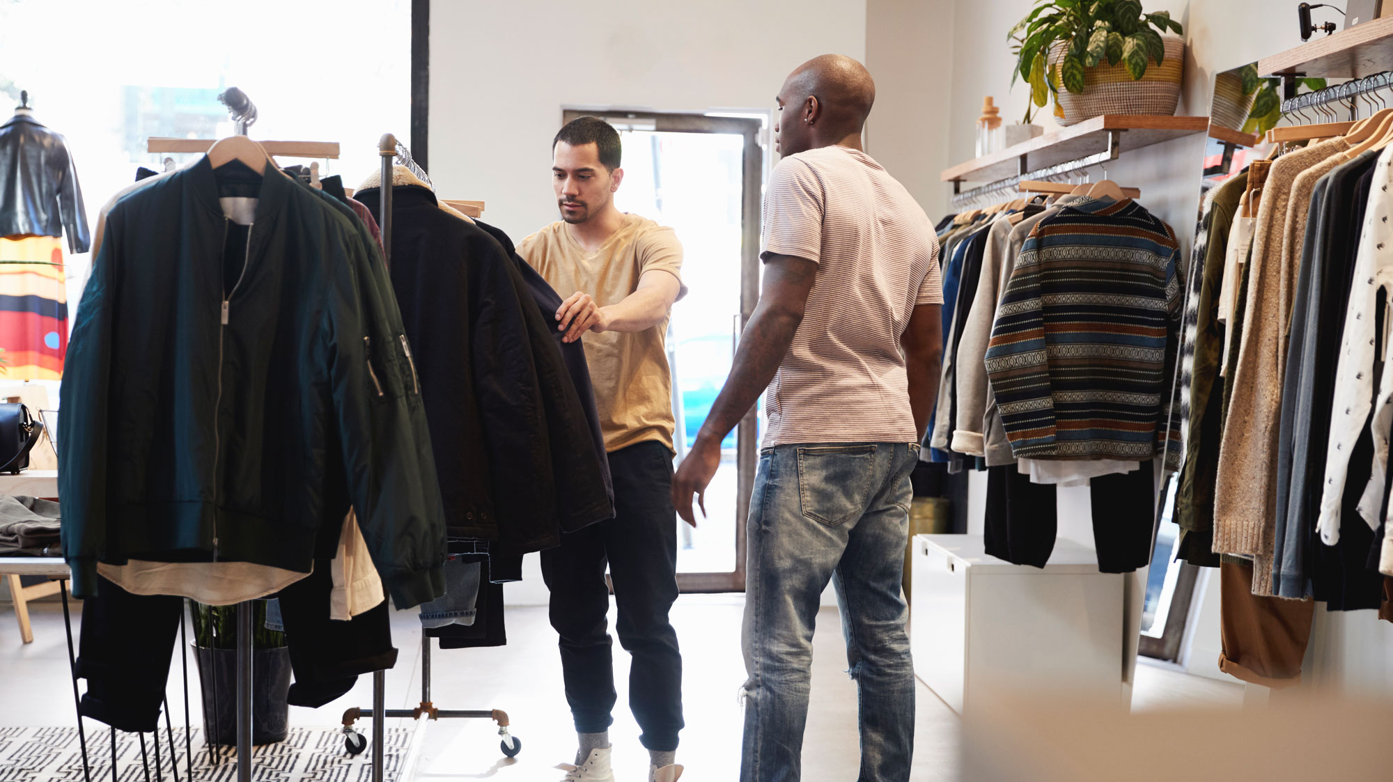Two men shopping for a jacket