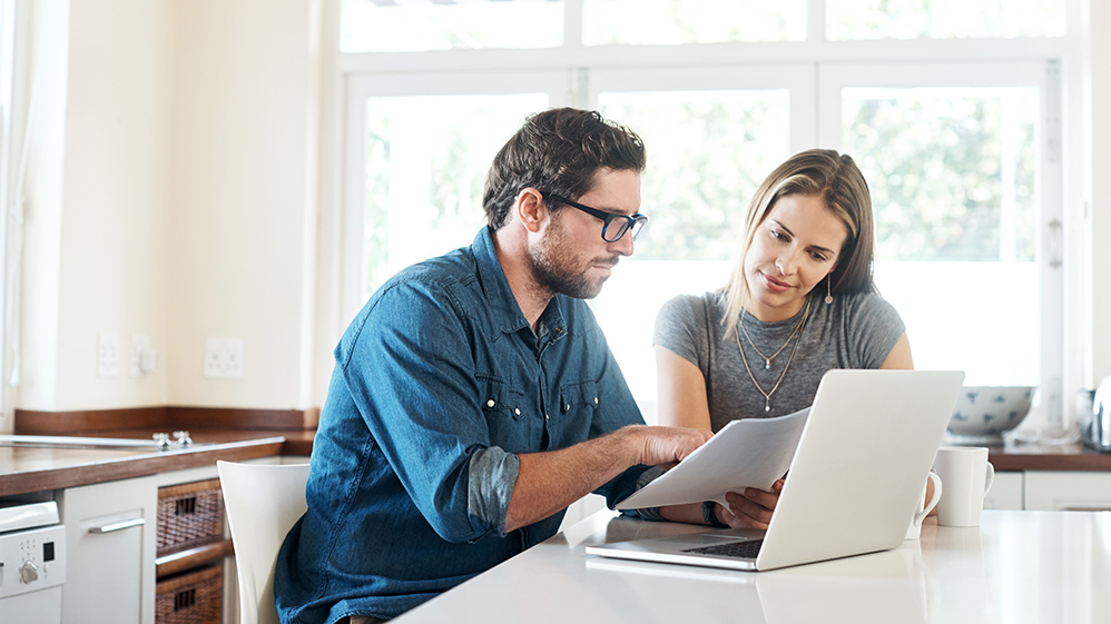 Photo of couple reviewing finances together