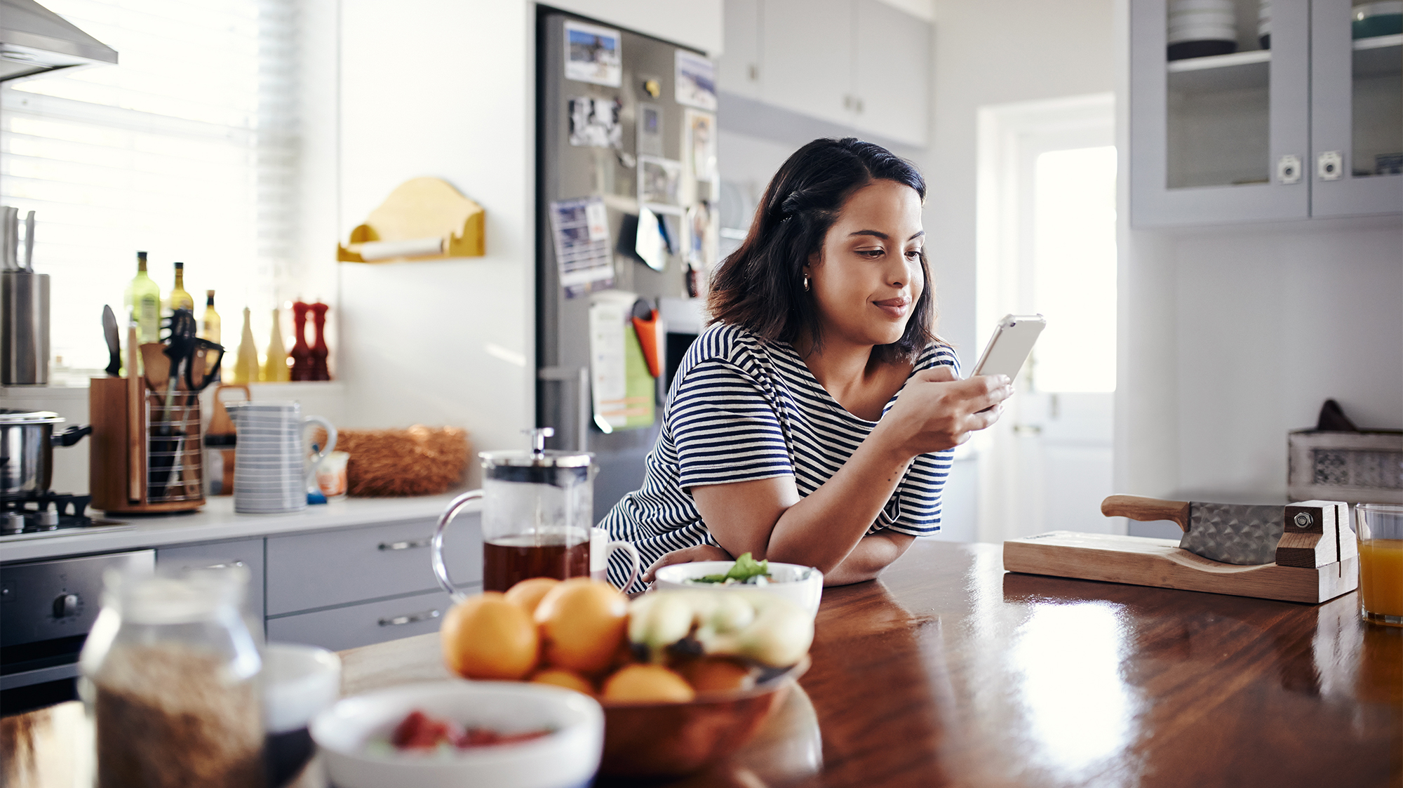 Girl In Kitchen Using Credit Insights on mobile phone