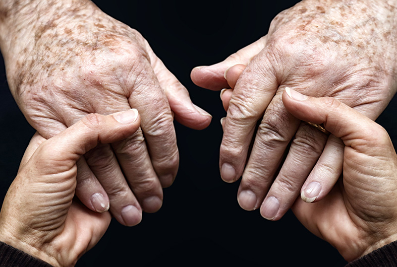 Photo of elderly and younger hands